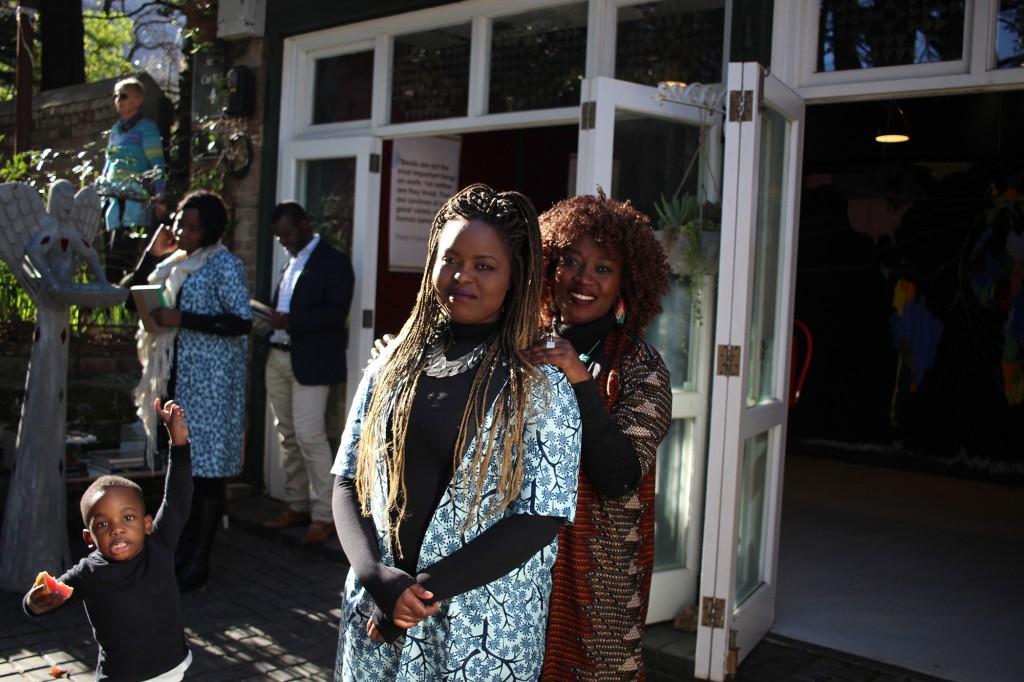 three artists, Iragena Philberte, Sandrine Uwizeye and Esther Kapinga (background)