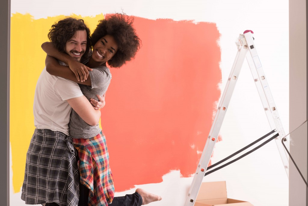 Young happy multiethnic couple hugging