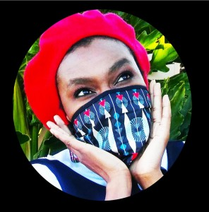 Designer, Glorinah Mabaso poses with the FRAFRA mask.